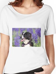 dog in a field of Blue lupin (Lupinus pilosus) flowers  Women's Relaxed Fit T-Shirt