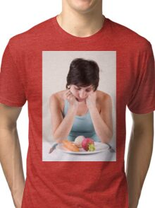 depressed female model with a plate of vegetables Tri-blend T-Shirt
