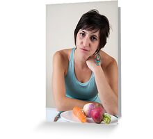 epressed female model in her 20s with a plate of vegetables Greeting Card