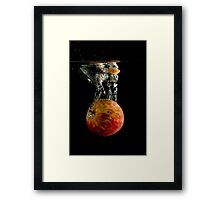 Red Apple Falling into Water Framed Print