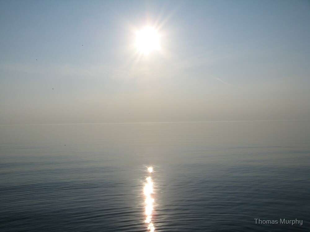 Sun Ray over Lake Michigan by Thomas Murphy