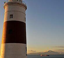 Lighthouse, Gibraltar with  Jebel Musa beyond by buttonpresser