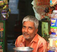 india, shop keeper by Ann Wang