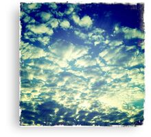 Puff Clouds Blanketing The Sky Canvas Print