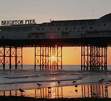 Sunset through Brighton Pier by Christian Williams