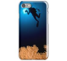 Underwater photograph of a diver swimming above an Anella Alcyonacea (soft corals) coral iPhone Case/Skin