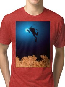 Underwater photograph of a diver swimming above an Anella Alcyonacea (soft corals) coral Tri-blend T-Shirt