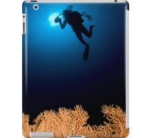 Underwater photograph of a diver swimming above an Anella Alcyonacea (soft corals) coral iPad Case/Skin
