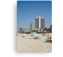 Israel, Tel Aviv, Holiday makers sunning on the beach Canvas Print