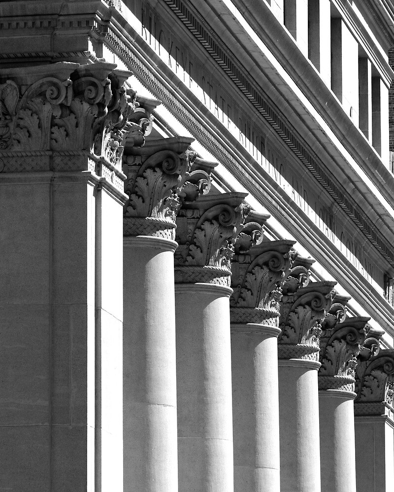 Row of classical columns by woodnimages