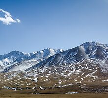 Beautiful snowy Tibetan high mountain landscape with the lonely cloud by Sergey Orlov