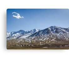 Beautiful snowy Tibetan high mountain landscape with the lonely cloud Canvas Print