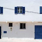 blue doors, blue windows, white walls by offpeaktraveler