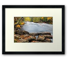 Huge boulders and colorful fall forest on a riverside Framed Print