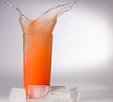 Splash of Juice in Glass with Ice by Riaan Roux