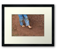 Kid dirty feet on muddy ground Framed Print