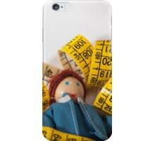 Doll resting on measuring tape iPhone Case/Skin
