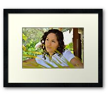 Young lady looking pensive Framed Print
