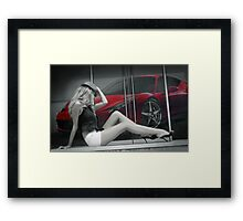 Attractive long leggy blond girl sitting in front of red Ferrari Framed Print