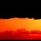Red, yellow and black sunrise. by Turi Caggegi