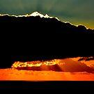 Shining behind clouds. by Turi Caggegi