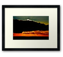 Shining behind clouds. Framed Print
