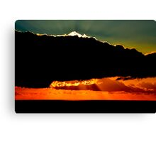Shining behind clouds. Canvas Print