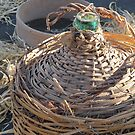 old wicker bottle and glass by james633