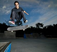 Skateboarder on a flip trick by homydesign