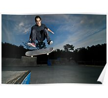 Skateboarder on a flip trick Poster