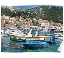blue boats in harbour at Hvar Poster