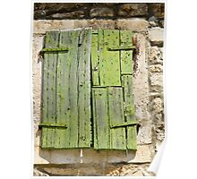 green shutters on stone building Poster
