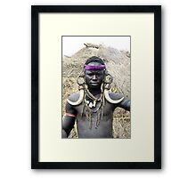 A Mursi tribesman warrior with warthog fangs earring decoration Framed Print