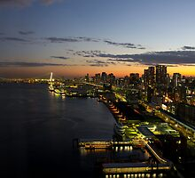 Sunset on Tokyo Bay featuring the Rainbow Bridge - Japan by Norman Repacholi