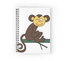 Funny brown monkey winks Spiral Notebook