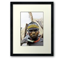Mursi tribesmen. A nomadic cattle herder ethnic group located in Southern Ethiopia,  Framed Print