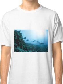 Scuba divers in the water  Classic T-Shirt