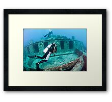 Divers at a shipwreck at Ras Mohammed National Park Framed Print