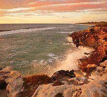 Last rays of the setting sun hit the coast by georgieboy98