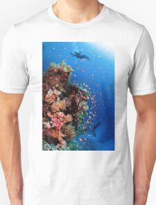 Scuba Divers pass by a coral reef photographed at Ras Mohammed  Unisex T-Shirt