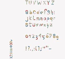 Alphabet in pieces of pattern paper by Sanne Thijs