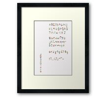 Alphabet in pieces of pattern paper Framed Print