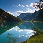 Clouds reflected in glacial waters by Birgit Van den Broeck