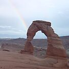 Rainbow by Rainbow Arch in Moab by Joseph Barney