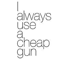 I always use a cheap gun Photographic Print
