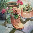Flowers In A Work Boot Planter by arline wagner
