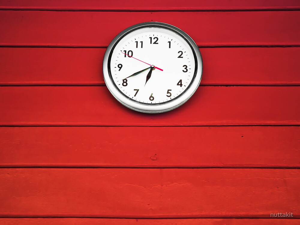 White clock on Red wall by nuttakit