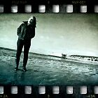 Standing on a beach by MWhitham