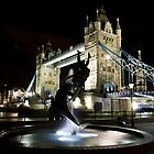 Girl and Dolphin Statue  And Tower Bridge at night by DavidHornchurch