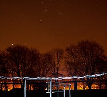 The Roundabout at Night... by Lauren Tucker
